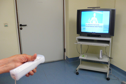 Patient with RA using the console's hand-held controller despite severe joint deformity. Photo: Jan Zernicke, Charité.